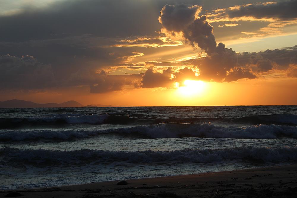 Zonsondergang bij Cala Violina - Toscane