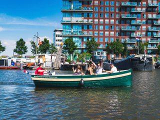 Must-do uitje in Nederland - Over de Amsterdamse grachten varen